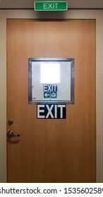 Exit door and emergency exit signs cascaded