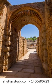 Exit gateway with arches of Roman Amphitheater, at the huge archaeological site of Merida. Founded by ancient Rome in western Spain
