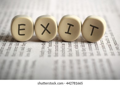 EXIT on newspaper, shallow depth of field image.