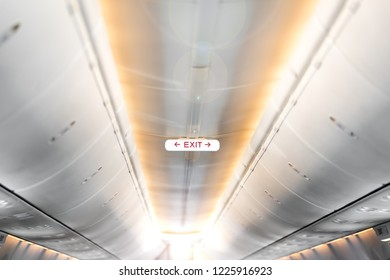 Exit sign in an aircraft interior , Empty seats Inside the airplane