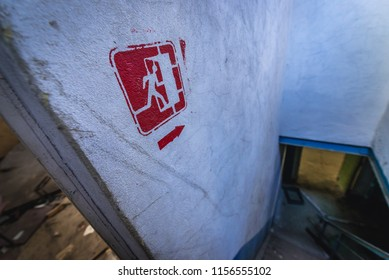 Exit sign in desolate factory in Pripyat desolate city in Chernobyl Exclusion Zone, Ukraine