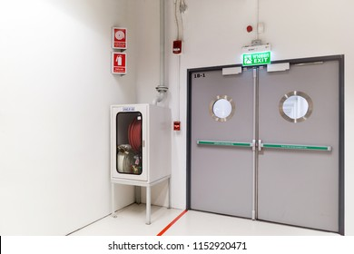 Exit sign and fire extinguisher at building.
