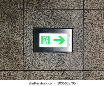 exit sign inside of limestone wall