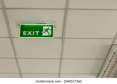 Exit sign on the ceiling.