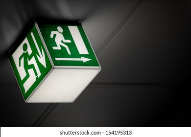 Exit sign on the wall in a building