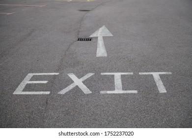 Exit sign painted on a asphalt