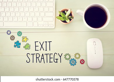 Exit Strategy concept with workstation on a light green wooden desk