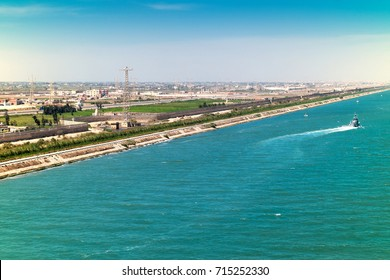 Exit from the Suez Canal into the Mediterranean along the harbor cities of Port Said and Port Fouad