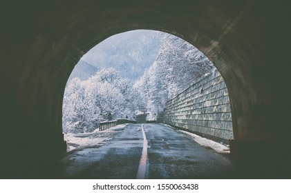 Exit from the tunnel with a view of high snow along the road,winter conditions on the mountain road