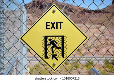Exit, yellow sign on the fence