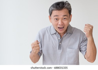 exited, confident, happy old senior or middle age asian man, aged with grey hair