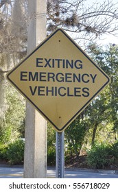 Exiting emergency vehicles sign