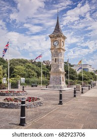 Exmouth, Devon, UK - The Jubilee Clock Tower on the Esplanade at Exmouth, Devon, with flags flying for Armed Forces Day.