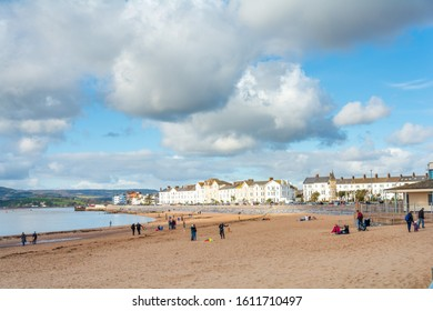 Exmouth, Devon/UK- February 17 2018: Holidaymakers enjoy a chilly winter day outdoors at Exmouth beach sea front