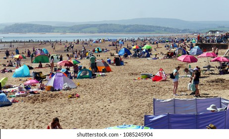 Exmouth. A seaside town in Devon South West England . Crowds flock to the beach on May Bank Holiday Sunday 2018