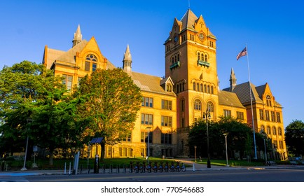 "An exotic, antique-style castle with golden dawn sunlight. The castle is known as 'Old Main"" building located in Wayne State University area, Midtown, Detroit, Michigan, USA."