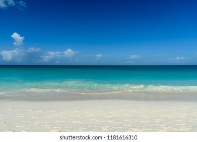 Exotic background with white sand beach and the Caribbean sea.