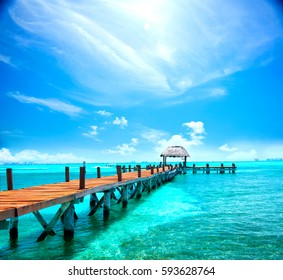 Exotic Beach, Paradise. Travel, Tourism and Vacations Concept. Landscape of Tropical Resort. Jetty near Cancun, Mexico