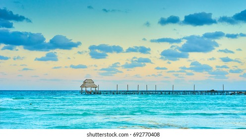 Exotic Beach, Paradise - Travel, Tourism and Vacations Concept. Landscape of Tropical Resort - Jetty near Cancun, Mexico