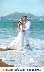 exotic beach wedding ceremony  honeymooners near the sea at sunset