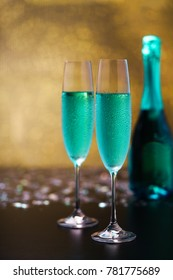 Exotic  blue champagne and gold bokeh background/Selective focus.Party and holiday celebration concept