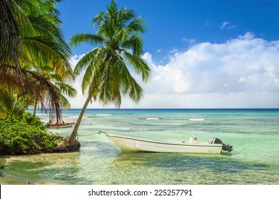 Exotic coast of the Dominican Republic with beautiful beach with moored fishing boat