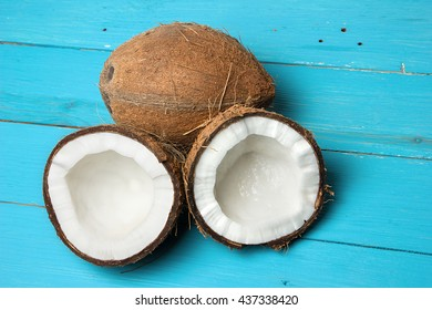 Exotic coconuts on a blue wooden background. Organic healthy food concept. Beauty and SPA concept.