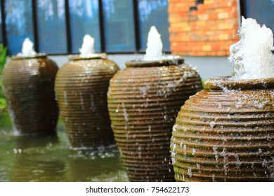 exotic fountain: water flows from the large amphorae which are along the walls of the building