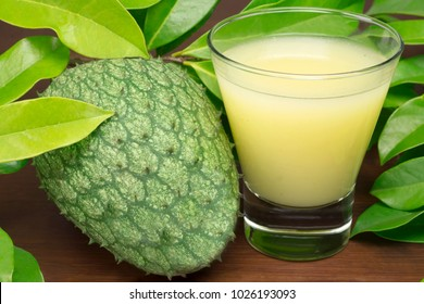 Exotic fruit Mountain soursop juice in wood background