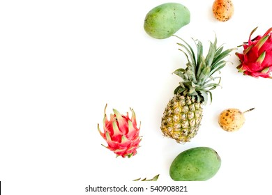 Exotic fruits: mango, pineapple, passion fruit and dragon fruit. Flat lay, top view