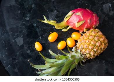Exotic fruits on dark background