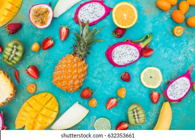 Exotic fruits on a  the turquoise background.