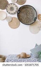 Exotic interior. Summer hat laying on bed indoors. Interior design elements. Flat lay, top view