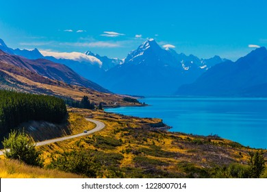 Exotic journey to the New Zealand. Huge picturesque Lake Tekapo with turquoise water. Concept of active and ecological tourism