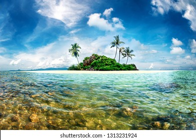 Exotic paradise island with palms and turquoise crystal clear sea. Amazing fantasy scenery island