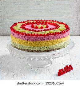 Exotic raw vegan cake decorated with fresh fruits