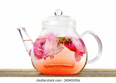 Exotic red tea with flowers in glass teapot