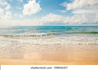 Exotic sea beach, tropical summer sea beach of Phuket island with sunny sky and clouds on horizon. Ocean beach relax, outdoor travel landscape, Thailand. Summer sea beach, sea shore travel photography