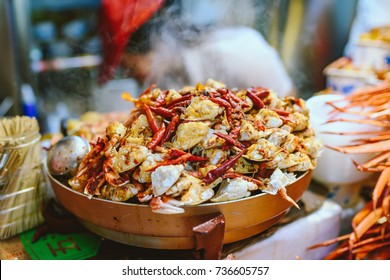 Exotic snacks and desserts can be found in this famous market Donghuamen Night food market near Wangfujing street, Beijing, China