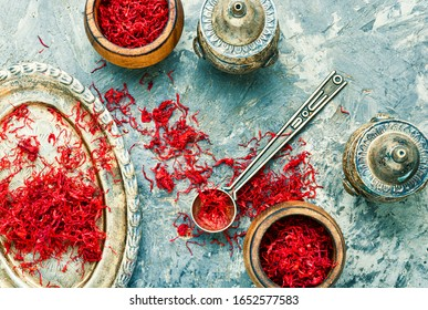Exotic spice, saffron on a vintage oriental tray - Shutterstock ID 1652577583