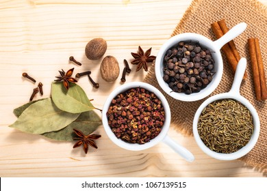 Exotic spices concept Chinese Asian Spices mix  Sichuan peppercorns, star anise pods, bay leave, black peppers, nutmegs, cloves and cinnamon sticks with copy space