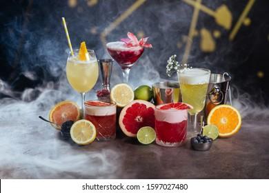 Exotic tasty alcoholic cocktails on dark background
