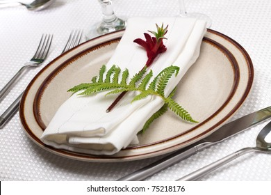 Exotic theme table setting. Arrangements with fresh fern and kangaroo paws flower