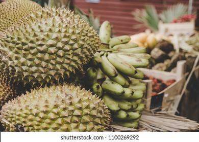 Exotic tropical fruits. Durian, jackfruit and bananas at street food market.