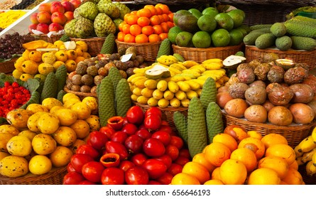 Exotic tropical fruits on the market. Edible bright background