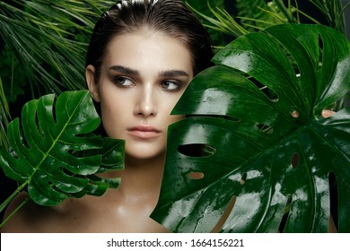 Exotic tropics beautiful woman looks towards palm tree