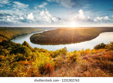 Exotic view of the sinuous river flowing through hills. Location Dnister or Dniestr canyon, Ukraine, Europe. Drone photography. An attractive summer scene on a nice day. Discover the beauty of earth.