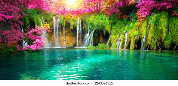 Exotic waterfall and lake panorama landscape of Plitvice Lakes, UNESCO natural world heritage and famous travel destination of Croatia. The waterfall located in central Croatia (Croatia proper). - Shutterstock ID 1243826515