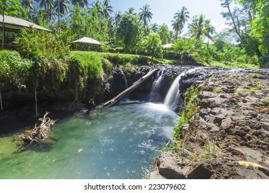 Exotic waterfall on the island of Upolu in Samoa