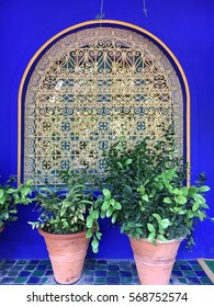 exotic window with blue walls and plants in the garden of Yves Saint Laurent, Morocco